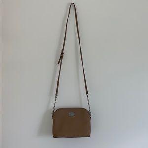 Tan crossbody Michael Kors purse